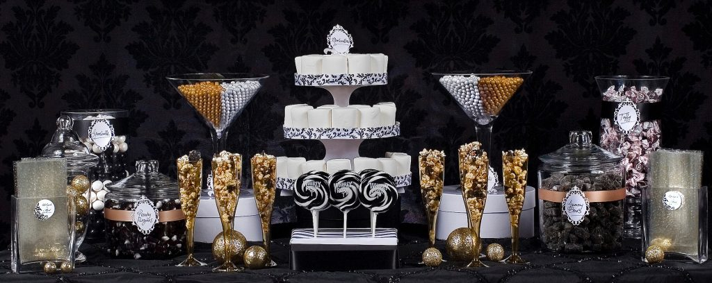 Black, white, and gold dessert candy table. How much to spend on a dessert table?